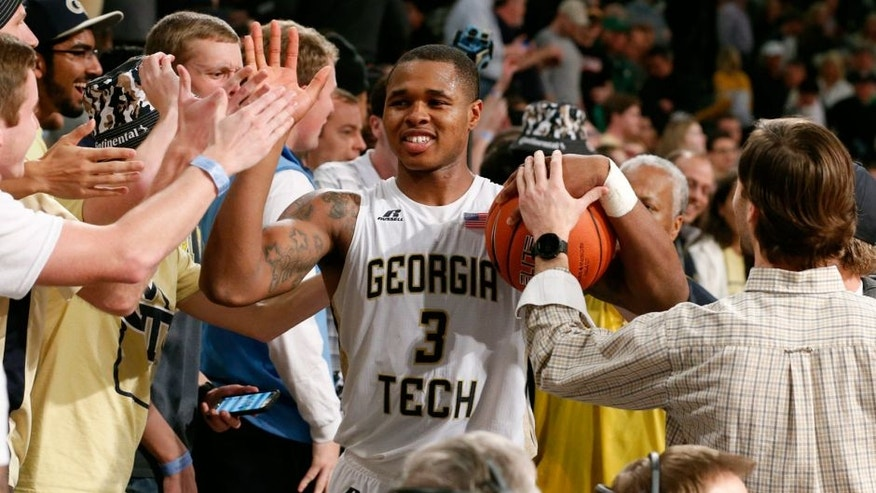 Feb 20, 2016; Atlanta, GA, USA; Georgia Tech Yellow Jackets Marcus Georges-Hunt (3) celebrates with fans after defeating the Notre Dame Fighting Irish 63-62 at McCamish Pavilion. Mandatory Credit: Jason Getz-USA TODAY Sports