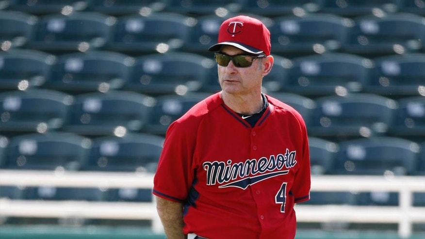 Minnesota Twins manager Paul Molitor watches as catchers run through drills at baseball spring training in Fort Myers, Fla. on Tuesday Feb. 24, 2015.