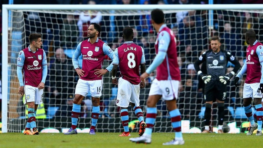 BIRMINGHAM, ENGLAND - FEBRUARY 14: Joleon Lescott of Aston Villa and team-mates show their dejection during the Barclays Premier League match between Aston Villa and Liverpool at Villa Park on February 14, 2016 in Birmingham, England. (Photo by Michael Steele/Getty Images)