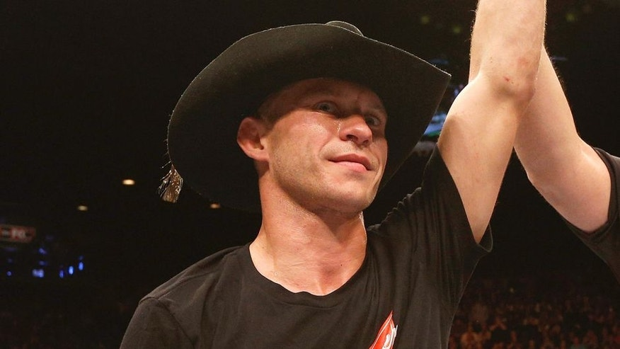 LAS VEGAS, NV - JANUARY 03: Donald Cerrone celebrates his victory over Myles Jury in their lightweight bout during the UFC 182 event on at the MGM Grand Garden Arena January 3, 2015 in Las Vegas, Nevada. (Photo by Josh Hedges/Zuffa LLC/Zuffa LLC via Getty Images)