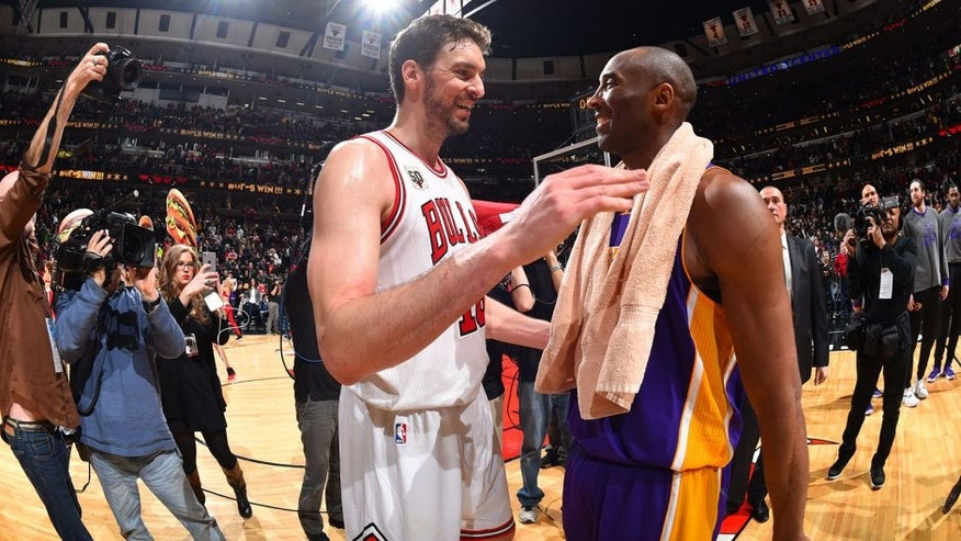CHICAGO, IL - FEBRUARY 21: Kobe Bryant #24 of the Los Angeles Lakers hugs his former teammate Pau Gasol #16 of the Chicago Bulls on February 21, 2016 at the United Center in Chicago, Illinois. NOTE TO USER: User expressly acknowledges and agrees that, by downloading and or using this Photograph, user is consenting to the terms and conditions of the Getty Images License Agreement. Mandatory Copyright Notice: Copyright 2016 NBAE (Photo by Jesse D. Garrabrant/NBAE via Getty Images)