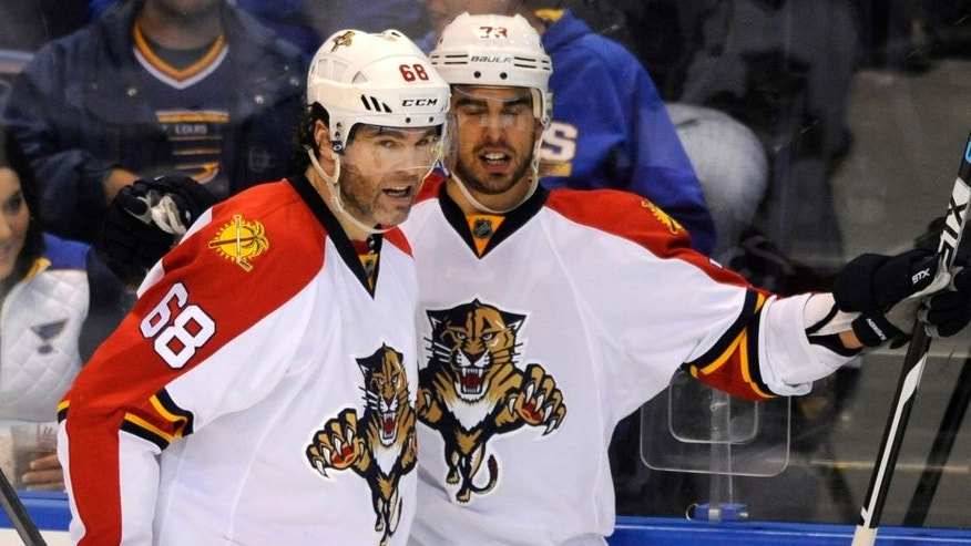 Florida Panthers' Brandon Pirri, right, celebrates with teammate Jaromir Jagr (68), of the Czech Republic, his goal against the St. Louis Blues during the second period of an NHL hockey game, Tuesday, Dec. 1, 2015, in St. Louis. (AP Photo/Bill Boyce)