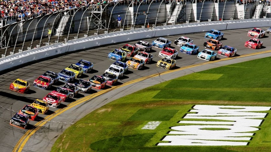 DAYTONA BEACH, FL - FEBRUARY 21: Denny Hamlin, driver of the #11 FedEx Express Toyota, leads the field during the NASCAR Sprint Cup Series DAYTONA 500 at Daytona International Speedway on February 21, 2016 in Daytona Beach, Florida. (Photo by Jerry Markland/Getty Images)