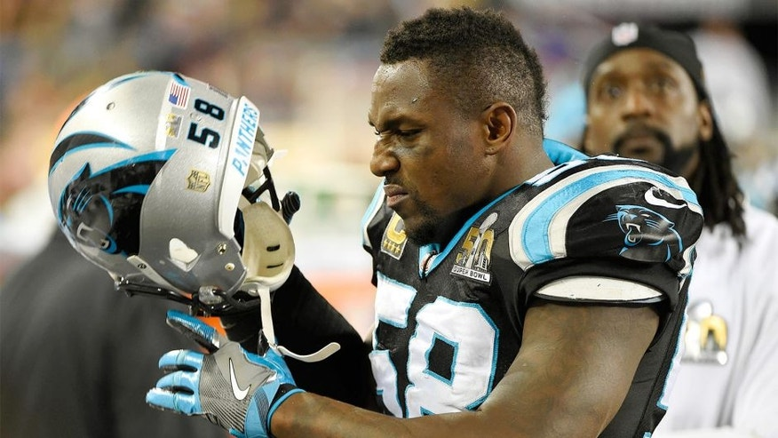 Carolina Panthers outside linebacker Thomas Davis (58) pulls his helmet off as injured cornerback Charles Tillman watches the video screen near the end of a 24-10 loss to the Denver Broncos in Super Bowl 50 at Levi's Stadium in Santa Clara, Calif., on Sunday, Feb. 7, 2016. (David T. Foster III/Charlotte Observer/TNS via Getty Images)