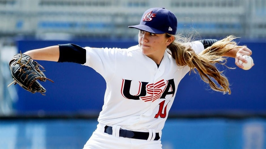 <p>Pitcher Sarah Hudek, of the United States, throws during a women's baseball game against Venezuela at the Pan Am Games Monday, July 20, 2015, in Ajax, Ontario. Women's baseball made history on Monday at the Pan Am Games, the first time it has been played in a large, multi-sport event.(AP Photo/Mark Humphrey)</p>