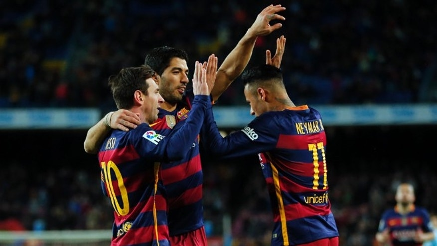 Neymar celebrates a goal with Luis Suárez and Lionel Messi in Barcelona, Spain, on Feb. 14, 2016.