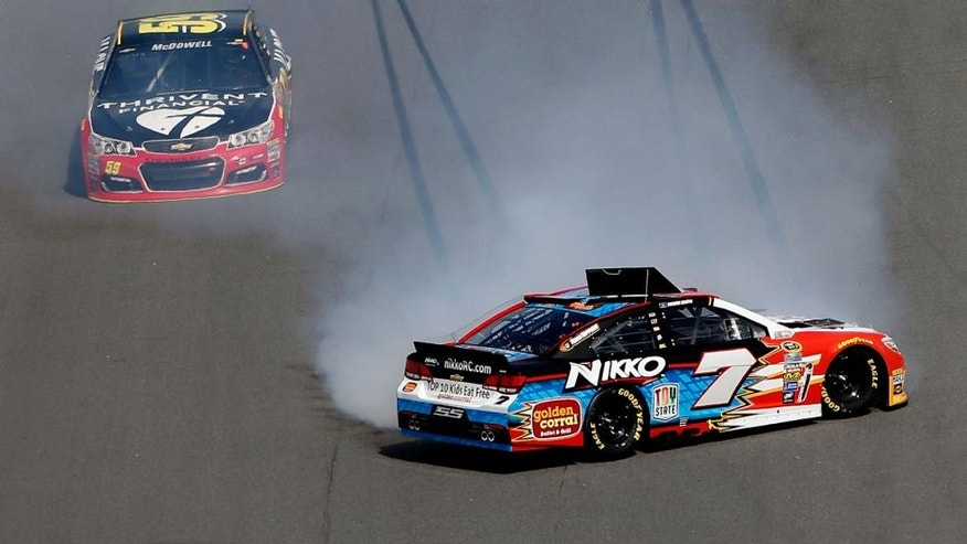 DAYTONA BEACH, FL - FEBRUARY 21: Regan Smith, driver of the #7 Nikko RC/Golden Corral Chevrolet, has an on track incident during the NASCAR Sprint Cup Series DAYTONA 500 at Daytona International Speedway on February 21, 2016 in Daytona Beach, Florida. (Photo by Brian Lawdermilk/Getty Images)