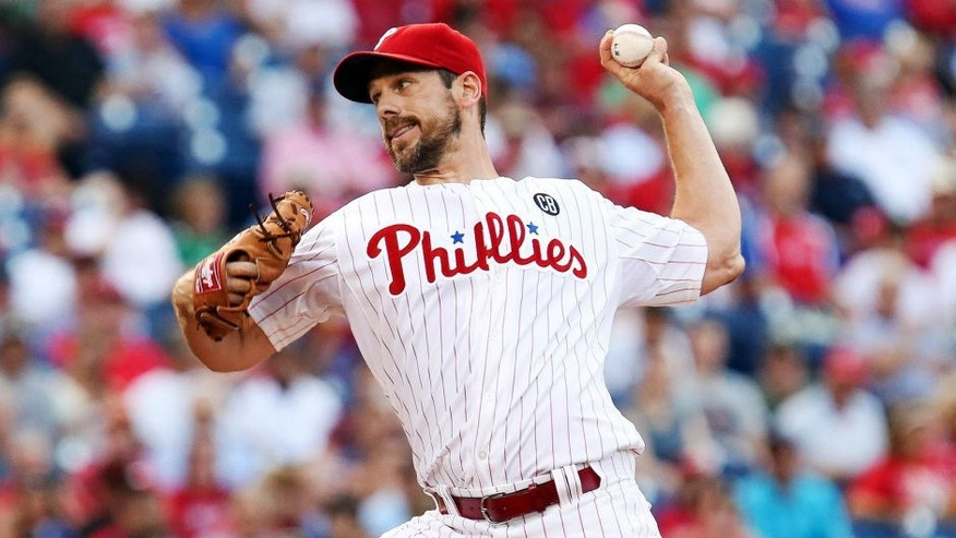 Jul 21, 2014; Philadelphia, PA, USA; Philadelphia Phillies starting pitcher Cliff Lee (33) pitches during the first inning of a game against the San Francisco Giants at Citizens Bank Park. Mandatory Credit: Bill Streicher-USA TODAY Sports