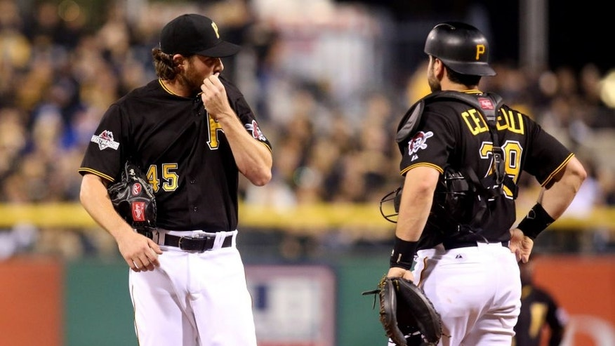 Oct 7, 2015; Pittsburgh, PA, USA; Pittsburgh Pirates starting pitcher Gerrit Cole (45) and catcher Francisco Cervelli (29) react after giving up a home run during the third inning in the National League Wild Card playoff baseball game at PNC Park. Mandatory Credit: Charles LeClaire-USA TODAY Sports