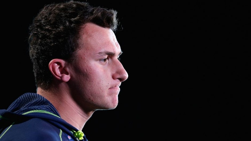 INDIANAPOLIS, IN - FEBRUARY 21: Former Texas A&M quarterback Johnny Manziel speaks to the media during the 2014 NFL Combine at Lucas Oil Stadium on February 21, 2014 in Indianapolis, Indiana. (Photo by Joe Robbins/Getty Images)