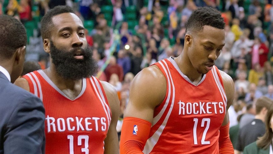 Feb 23, 2016; Salt Lake City, UT, USA; Houston Rockets guard James Harden (13) and center Dwight Howard (12) leave the court after the game against the Utah Jazz at Vivint Smart Home Arena. Utah won in overtime 117-114. Mandatory Credit: Russ Isabella-USA TODAY Sports