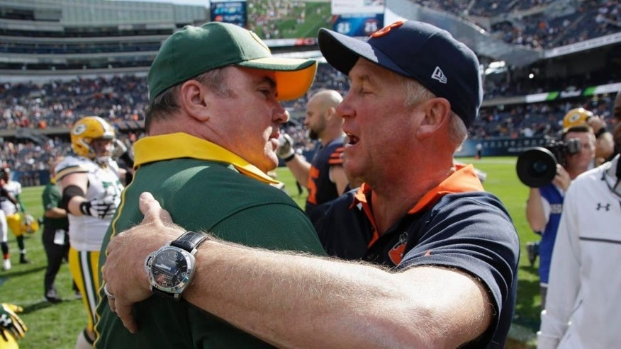 Green Bay Packers head coach Mike McCarthy and Chicago Bears head coach John Fox talk after their NFL football game, Sunday, Sept. 13, 2015, in Chicago. The Packers won 31-23.