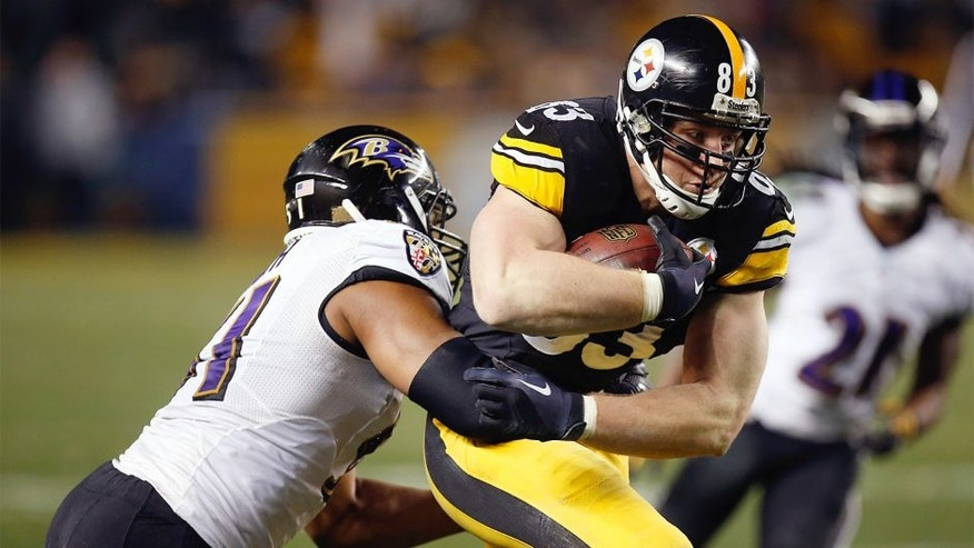 PITTSBURGH, PA - JANUARY 03: Heath Miller #83 of the Pittsburgh Steelers is tackled by Daryl Smith #51 of the Baltimore Ravens during their AFC Wild Card game at Heinz Field on January 3, 2015 in Pittsburgh, Pennsylvania. (Photo by Gregory Shamus/Getty Images)