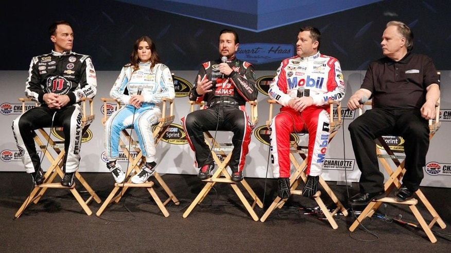 CHARLOTTE, NC - JANUARY 21: Kurt Busch talks as his fellow drivers Kevin Harvick, Danica Patrick, Tony Stewart and team owner, Gene Haas listen during the NASCAR 2016 Charlotte Motor Speedway Media Tour on January 21, 2016 in Charlotte, North Carolina. Bob Leverone / NASCAR via Getty Images (Photo by Bob Leverone/NASCAR via Getty Images)