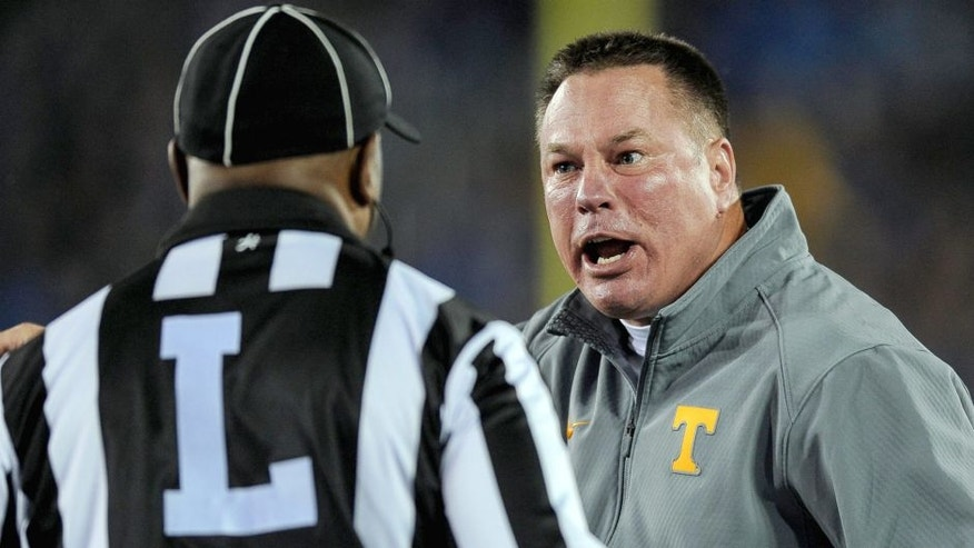 Oct 31, 2015; Lexington, KY, USA; Tennessee Volunteers head coach Butch Jones argues a call with the referee against the Kentucky Wildcats at Commonwealth Stadium. Mandatory Credit: Bryan Lynn-USA TODAY Sports