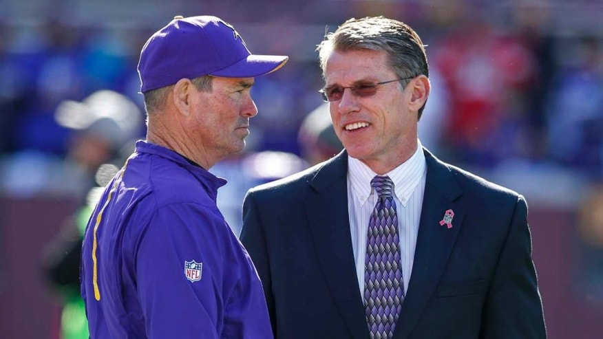 Minnesota Vikings head coach Mike Zimmer (left) speaks with general manager Rick Spielman prior to their game against the Kansas City Chiefs at TCF Bank Stadium in Minneapolis on Sunday, Oct. 18, 2015.