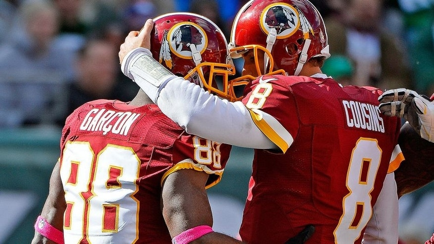 EAST RUTHERFORD, NJ - OCTOBER 18: Pierre Garcon #88 of the Washington Redskins is congratulated by his teammate Kirk Cousins #8 after scoring a first quarter touchdown at MetLife Stadium on October 18, 2015 in East Rutherford, New Jersey. (Photo by Alex Goodlett/Getty Images)