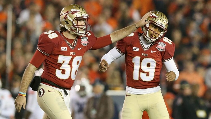 Jan 6, 2014; Pasadena, CA, USA; Florida State Seminoles kicker Roberto Aguayo (19) is congratulated by punter Cason Beatty (38) after he kicked a 41 yard field goal against the Auburn Tigers during the second half of the 2014 BCS National Championship game at the Rose Bowl. Mandatory Credit: Matthew Emmons-USA TODAY Sports