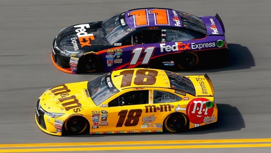 DAYTONA BEACH, FL - FEBRUARY 21: Kyle Busch, driver of the #18 M&M's 75 Toyota, races Denny Hamlin, driver of the #11 FedEx Express Toyota, during the NASCAR Sprint Cup Series DAYTONA 500 at Daytona International Speedway on February 21, 2016 in Daytona Beach, Florida. (Photo by Jonathan Ferrey/Getty Images)
