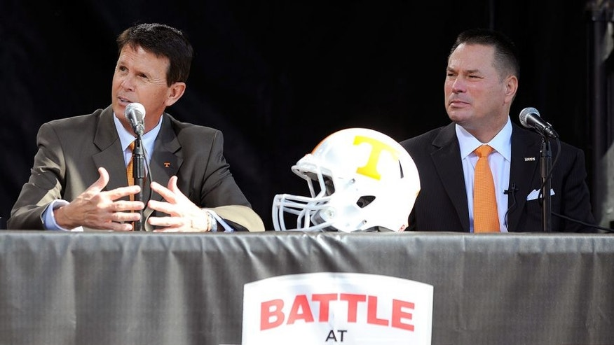 BRISTOL, TN - OCTOBER 14: Dave Hart(L), Tennessee Vice Chancellor/Athletic Director, and Butch Jones, Tennessee Head Coach, speak during a press conference at Bristol Motor Speedway on October 14, 2013 in Bristol, Tennessee. Bristol Motor Speedway plans to transform the legendary Speedway into the world's largest football stadium for the inaugural Battle at Bristol, College Football's Biggest EVER game to be held on Saturday, September 10, 2016. The event will feature a border battle between the Virginia Tech Hokies and Tennessee Volunteers and is projected to set the NCAA record for highest single-game attendance. (Photo by Jared C. Tilton/Getty Images for Bristol Motor Speedway)