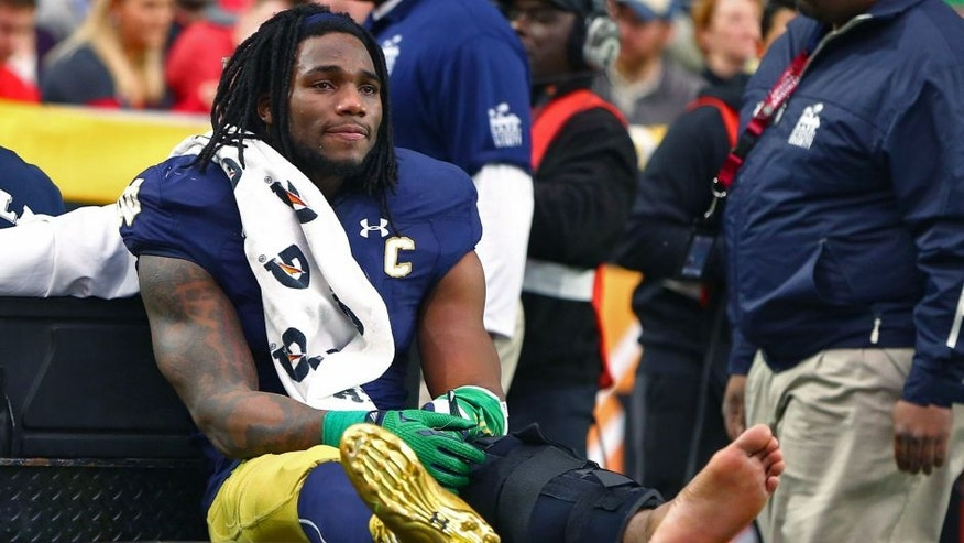 Jan 1, 2016; Glendale, AZ, USA; Notre Dame Fighting Irish linebacker Jaylon Smith (9) cries as he is carted off the field after suffering an injury un the first quarter against the Ohio State Buckeyes during the 2016 Fiesta Bowl at University of Phoenix Stadium. Mandatory Credit: Mark J. Rebilas-USA TODAY Sports