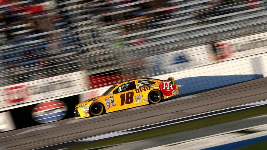 HAMPTON, GA - FEBRUARY 26: Kyle Busch drives the #18 M&M's 75 Toyota during qualifying for the NASCAR Sprint Cup Series Folds of Honor QuikTrip 500 at Atlanta Motor Speedway on February 26, 2016 in Hampton, Georgia. (Photo by Matt Sullivan/NASCAR via Getty Images)