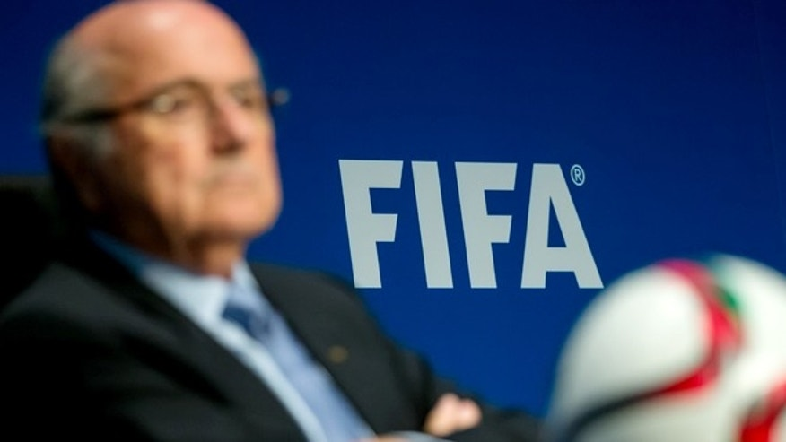 ZURICH, SWITZERLAND - MARCH 20: A FIFA logo sits on a wall behind FIFA President Joseph S. Blatter during a press conference at the end of the FIFA Executive Comitee meeting at the FIFA headquarters on March 20, 2015 in Zurich, Switzerland. (Photo by Philipp Schmidli/Getty Images)