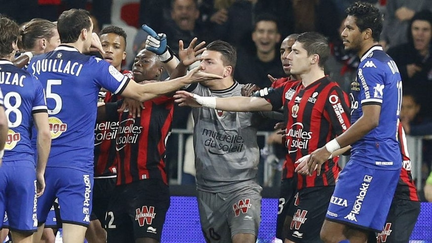 "Players of both teams clash during the French L1 football match Nice (OGC Nice) vs Bastia (SCB) on February 26, 2016 at the ""Allianz Riviera"" stadium in Nice, southeastern France. AFP PHOTO / VALERY HACHE / AFP / VALERY HACHE (Photo credit should read VALERY HACHE/AFP/Getty Images)"