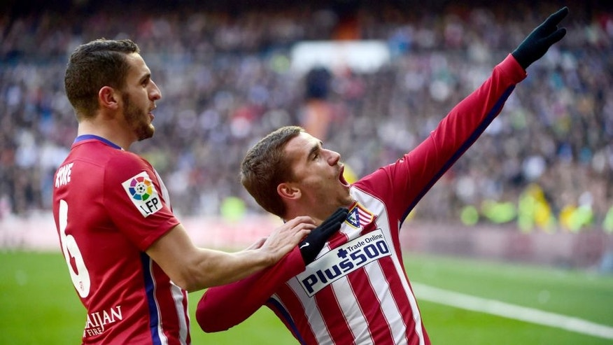 Atletico Madrid's French forward Antoine Griezmann (R) celebrates with Atletico Madrid's midfielder Koke after scoring during the Spanish league football match Real Madrid CF vs Atletico de Madrid at the Santiago Bernabeu stadium in Madrid on February 27, 2016. / AFP / PIERRE-PHILIPPE MARCOU (Photo credit should read PIERRE-PHILIPPE MARCOU/AFP/Getty Images)