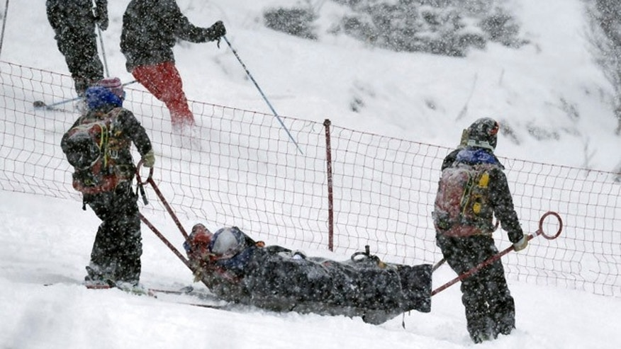 Lindsey Vonn, of the United States, is being carried out of the course on a rescue sled after falling during a women's World Cup alpine ski super G race, in Soldeu, Andorra, Saturday, Feb. 27, 2016. (AP Photo)