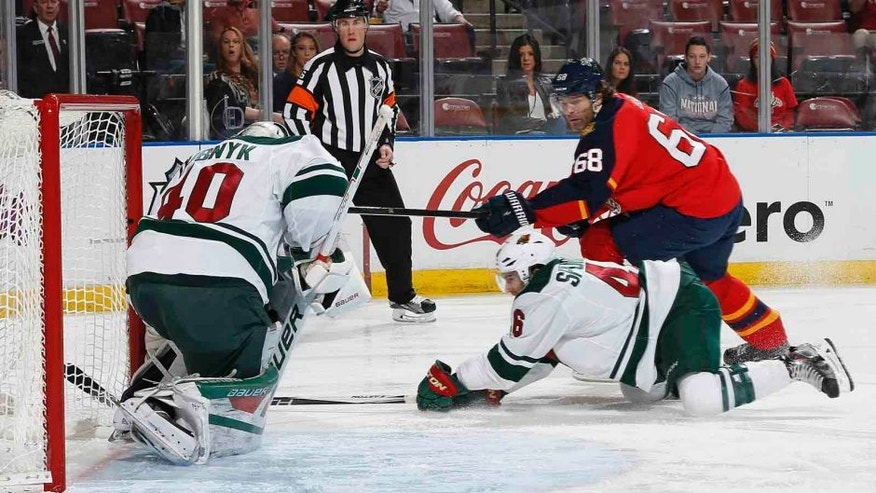 Florida Panthers forward Jaromir Jagr (right) scores a goal past Minnesota Wild goaltender Devan Dubnyk during the first period Sunday, Jan. 3, 2016, in Sunrise, Fla.