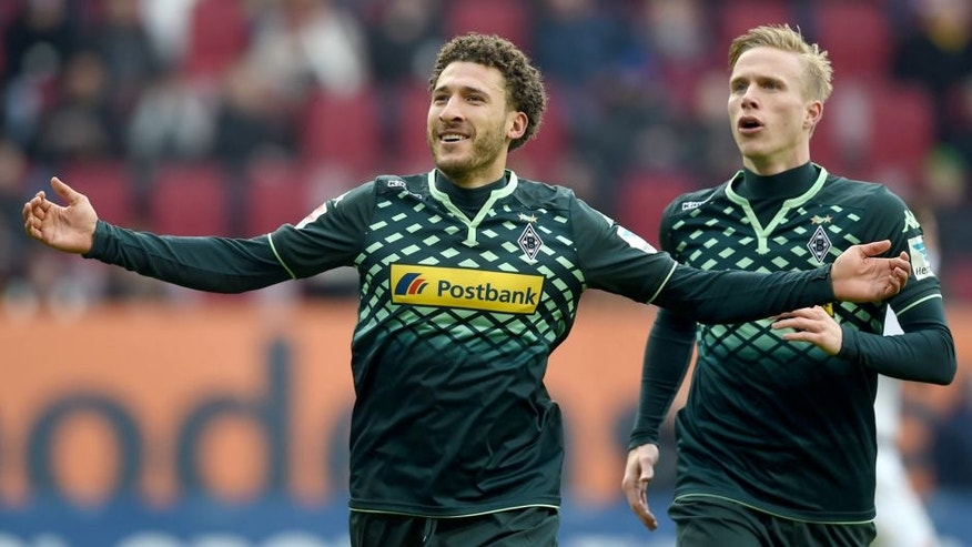Moenchengladbach's US defender Fabian Johnson (L) and Moenchengladbach's Swedish defender Oscar Wendt celebrate after the second goal for Moenchengladbach during the German first division Bundesliga football match of FC Augsburg vs Borussia Moenchengladbach in Augsburg, southern Germany, on February 28, 2016. / AFP / CHRISTOF STACHE / RESTRICTIONS: DURING MATCH TIME: DFL RULES TO LIMIT THE ONLINE USAGE TO 15 PICTURES PER MATCH AND FORBID IMAGE SEQUENCES TO SIMULATE VIDEO. == RESTRICTED TO EDITORIAL USE == FOR FURTHER QUERIES PLEASE CONTACT DFL DIRECTLY AT + 49 69 650050 (Photo credit should read CHRISTOF STACHE/AFP/Getty Images)