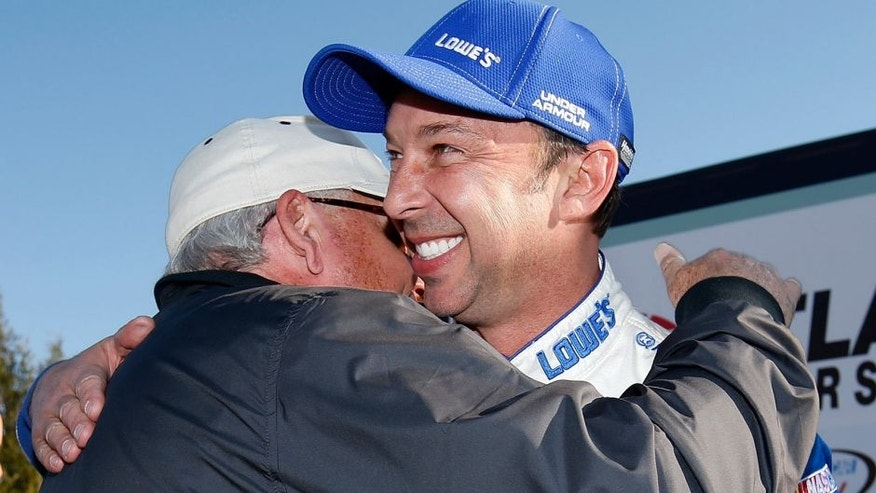 HAMPTON, GA - FEBRUARY 28: Chad Knaus, crew chief of Jimmie Johnson, driver of the #48 Lowe's Chevrolet, celebrates with team owner Rick Hendrick after winning the NASCAR Sprint Cup Series Folds of Honor QuikTrip 500 at Atlanta Motor Speedway on February 28, 2016 in Hampton, Georgia. (Photo by Todd Warshaw/NASCAR via Getty Images)