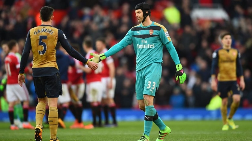 MANCHESTER, ENGLAND - FEBRUARY 28: Petr Cech of Arsenal shakes hands with Gabriel Paulista of Arsenal after the Barclays Premier League match between Manchester United and Arsenal at Old Trafford on February 28, 2016 in Manchester, England. (Photo by Laurence Griffiths/Getty Images)