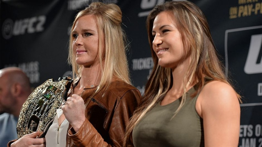 LAS VEGAS, NV - JANUARY 20: (L-R) UFC bantamweight champion Holly Holm and Miesha Tate pose for a picture during the UFC 197 on-sale press conference event inside MGM Grand Hotel & Casino on January 20, 2016 in Las Vegas, Nevada. (Photo by Brandon Magnus/Zuffa LLC/Zuffa LLC via Getty Images)