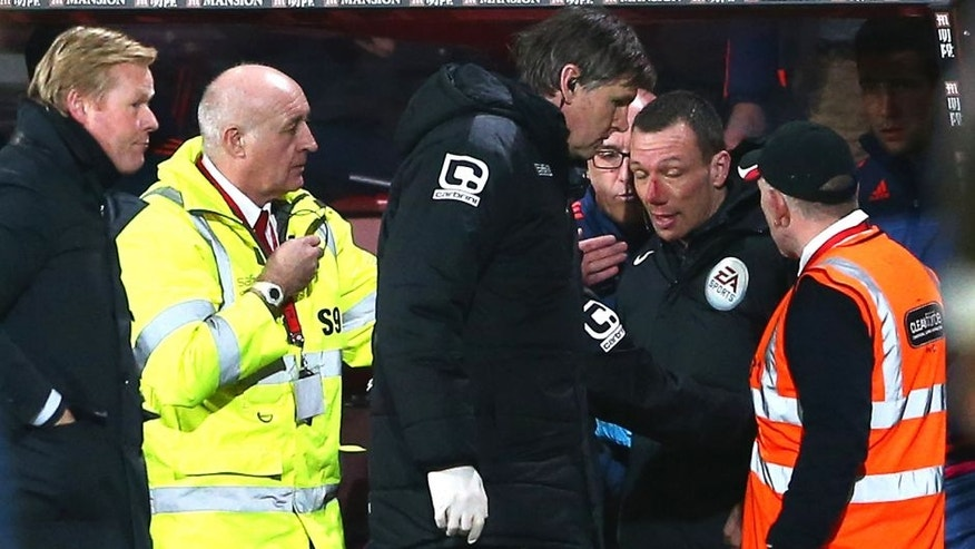 BOURNEMOUTH, ENGLAND - MARCH 01: Blooded fourth official Kevin Friend receives treatment by team staffs during the Barclays Premier League match between A.F.C. Bournemouth and Southampton at Vitality Stadium on March 1, 2016 in Bournemouth, England. (Photo by Michael Steele/Getty Images)
