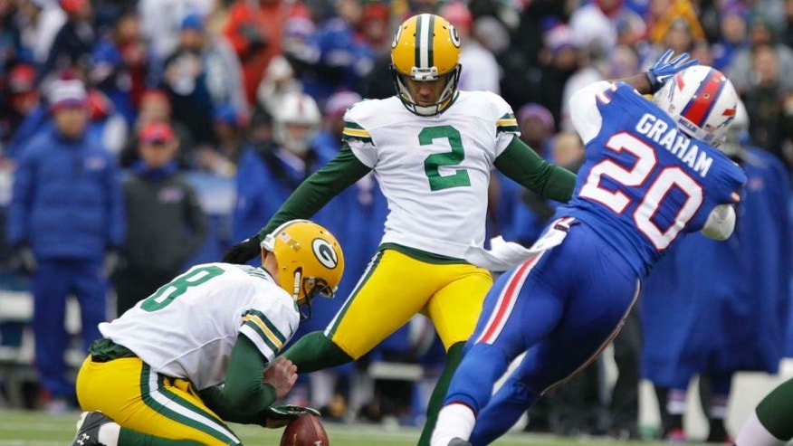 Green Bay Packers kicker Mason Crosby (center) boots a field goal during the first half against the Buffalo Bills.