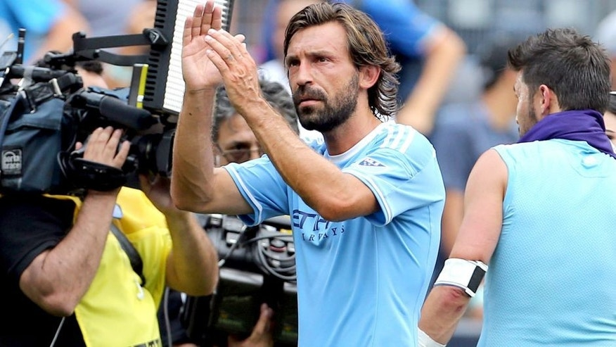 Jul 26, 2015; New York, NY, USA; New York City FC midfielder Andrea Pirlo (21) leaves the field after defeating the Orlando City FC in a soccer match at Yankee Stadium. The New York City FC won 5-3. Mandatory Credit: Adam Hunger-USA TODAY Sports