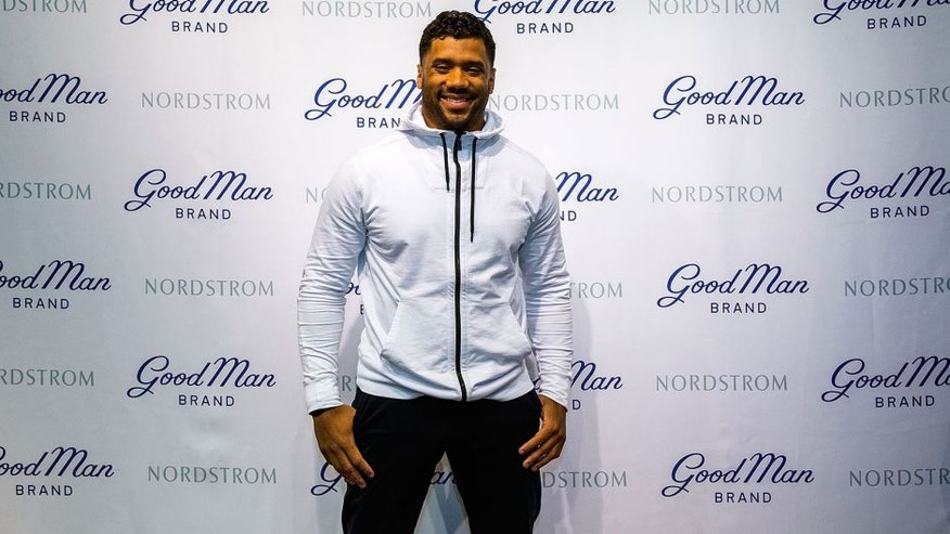 SEATTLE, WA - FEBRUARY 29: Seattle Seahawks quarterback Russell Wilson poses for a photo at Nordstrom on February 29, 2016 in Seattle, Washington. (Photo by Suzi Pratt/Getty Images for Nordstrom)
