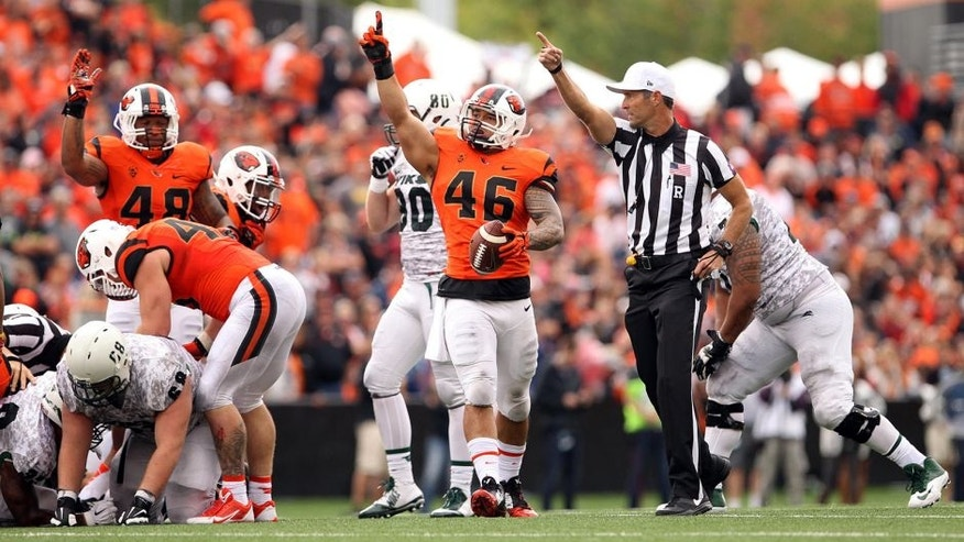 Aug 30, 2014; Corvallis, OR, USA; Oregon State Beavers linebacker Rommel Mageo (46) celebrates after recovering a fumble against Portland State Vikings at Reser Stadium. Mandatory Credit: Jaime Valdez-USA TODAY Sports