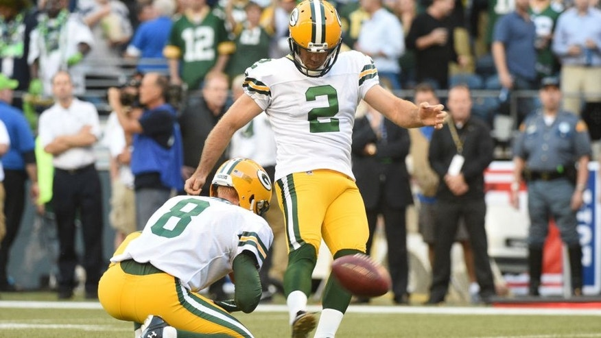 <p>Sep 4, 2014; Seattle, WA, USA; Green Bay Packers kicker Mason Crosby (2) kicks a field goal out of the hold by punter Tim Masthay (8) during the second quarter at CenturyLink Field. Mandatory Credit: Kyle Terada-USA TODAY Sports</p>