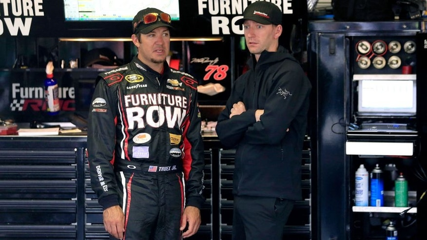 LONG POND, PA - JUNE 06: Martin Truex Jr., driver of the #78 Furniture Row/Visser Precision Chevrolet, left, talks with crew chief Cole Pearn during in the garage area practice for the NASCAR Sprint Cup Series Axalta 'We Paint Winners' 400 at Pocono Raceway on June 6, 2015 in Long Pond, Pennsylvania. (Photo by Chris Trotman/Getty Images)