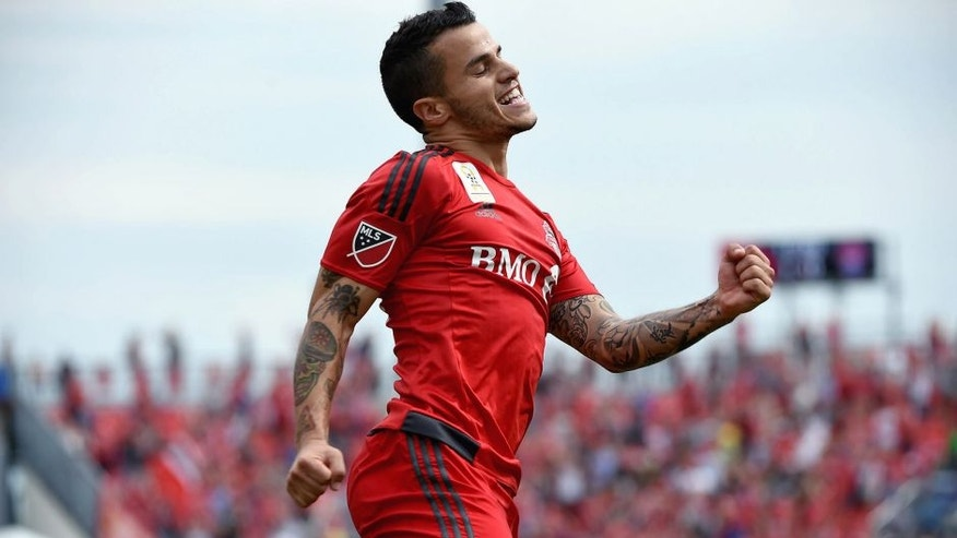 Sep 19, 2015; Toronto, Ontario, CAN; Toronto FC forward Sebastian Giovinco (10) reacts after scoring his second goal against Colorado Rapids in the first half at BMO Field. Mandatory Credit: Dan Hamilton-USA TODAY Sports
