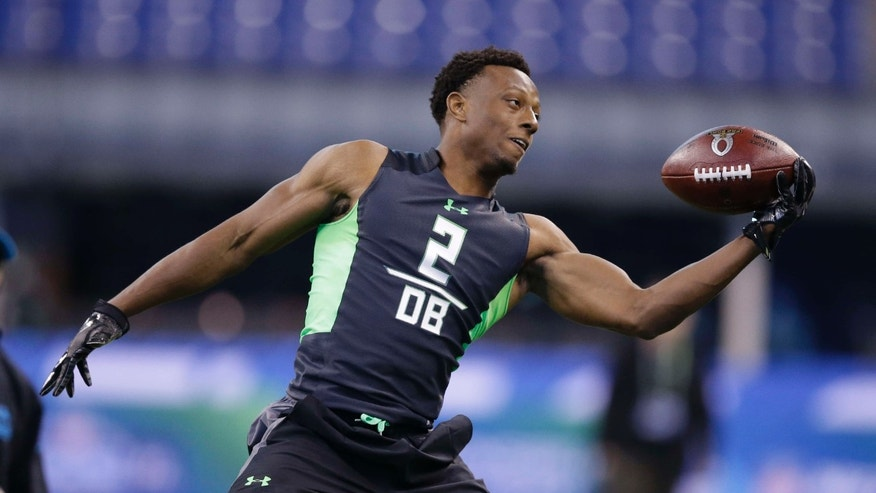 In this Feb. 29, 2016, file photo, Ohio State defensive back Eli Apple runs a drill at the NFL football scouting combine in Indianapolis.