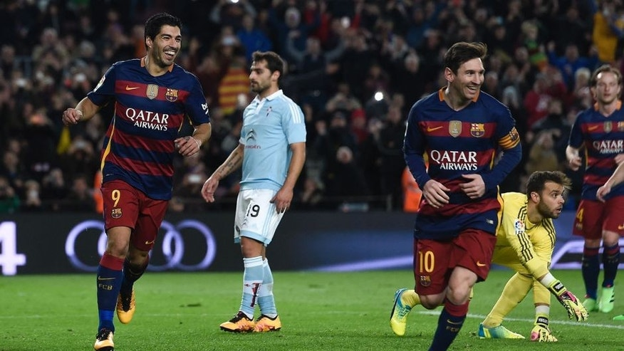 Barcelona's Uruguayan forward Luis Suarez (L) celebrates his goal with Barcelona's Argentinian forward Lionel Messi (3rd R) during the Spanish league football match FC Barcelona vs RC Celta de Vigo at the Camp Nou stadium in Barcelona on February 14, 2016. / AFP / JOSEP LAGO (Photo credit should read JOSEP LAGO/AFP/Getty Images)