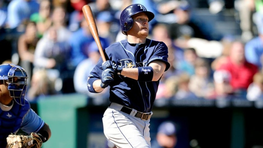 KANSAS CITY, MO - OCTOBER 3: Dan Johnson #24 of the Tampa Bay Rays bats against the Kansas City Royals at Kauffman Stadium on October 3, 2010 in Kansas City, Missouri. The Rays defeated the Royals 3-2 in 12 innings to clinch the American League East Division. (Photo by John Williamson/MLB Photos via Getty Images)