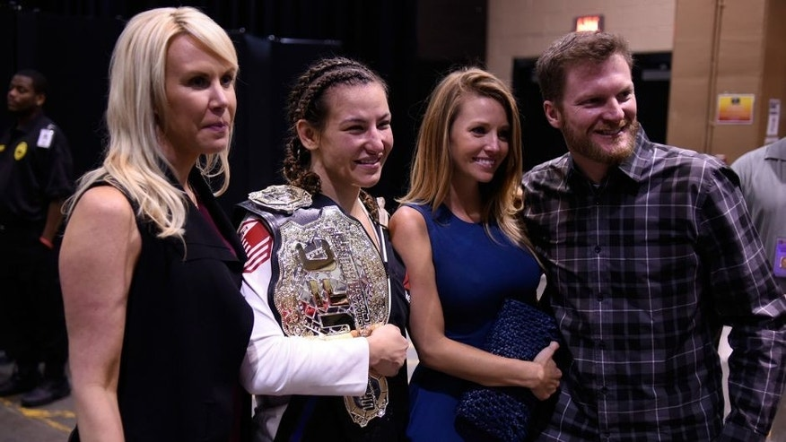 LAS VEGAS, NV - MARCH 05: (L-R) DeLana Harvick, Miesha Tate, Amy Reimann and NASCAR driver Dale Earnhardt, Jr. backstage during the UFC 196 event inside MGM Grand Garden Arena on March 5, 2016 in Las Vegas, Nevada. (Photo by Todd Lussier/Zuffa LLC/Zuffa LLC via Getty Images)