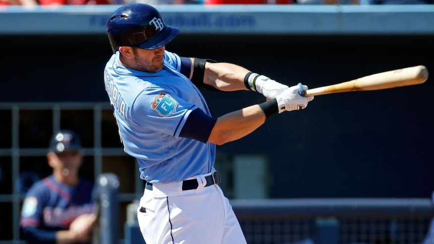 Tampa Bay Rays' Evan Longoria doubles in the third inning of a spring training baseball game against the Minnesota Twins in Port Charlotte, Fla., Sunday, March 6, 2016. (AP Photo/Patrick Semansky)