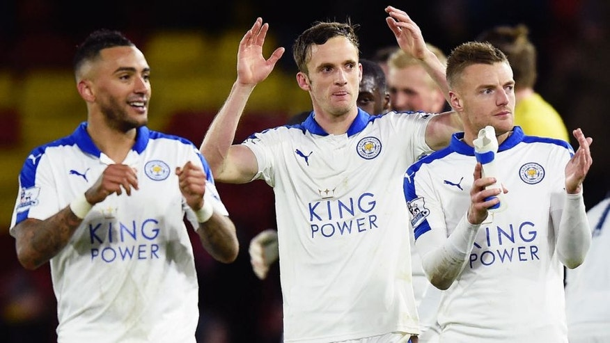 Leicester City's English defender Danny Simpson (L), Leicester City's Welsh midfielder Andy King (C) and Leicester City's English striker Jamie Vardy appluad the fans following the English Premier League football match between Watford and Leicester City at Vicarage Road Stadium in Watford, north of London on March 5, 2016. Leicester won the match 1-0. / AFP / OLLY GREENWOOD / RESTRICTED TO EDITORIAL USE. No use with unauthorized audio, video, data, fixture lists, club/league logos or 'live' services. Online in-match use limited to 75 images, no video emulation. No use in betting, games or single club/league/player publications. / (Photo credit should read OLLY GREENWOOD/AFP/Getty Images)