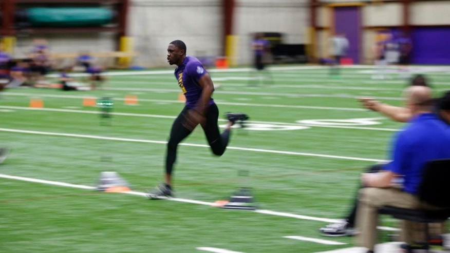 In this image taken with a slow shutter speed, South Dakota cornerback Michael Lilly is timed as he runs the 40-yard-dash during a regional NFL football combine at the Minnesota Vikings' Winter Park facility Saturday, March 5, 2016, in Eden Prairie, Minn.